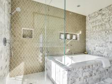 Large Modern Bathroom Featuring a Glass Shower and Jacuzzi Tub With Patterned Tile Accent Wall