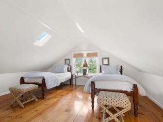 White Attic Bedroom With Twin Beds