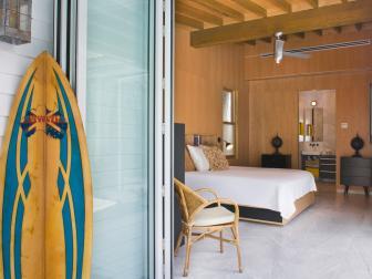 Wood Paneled Bedroom and Surfboard