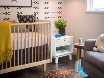 Eclectic Bohemian Nursery With Arrow Wallpaper