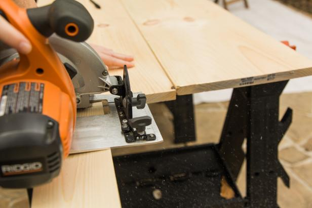 "If you're not into using a jigsaw or circular saw you can easily pick up an 8 foot long piece of 1""x 4"" at the home improvement store and have them cut a few 18 inch long pieces. If not, measure, mark and cut them yourself at home. Be sure to use eye protection!  Cut at least three or four boards, as they'll support the rolling base. We went with three but if we built it again we'd go with four to make it even sturdier!"