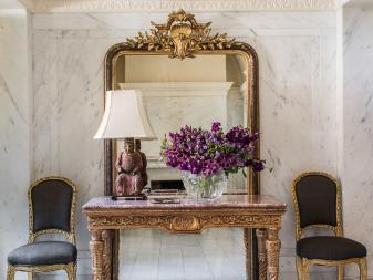 Foyer With Gold Table and Mirror
