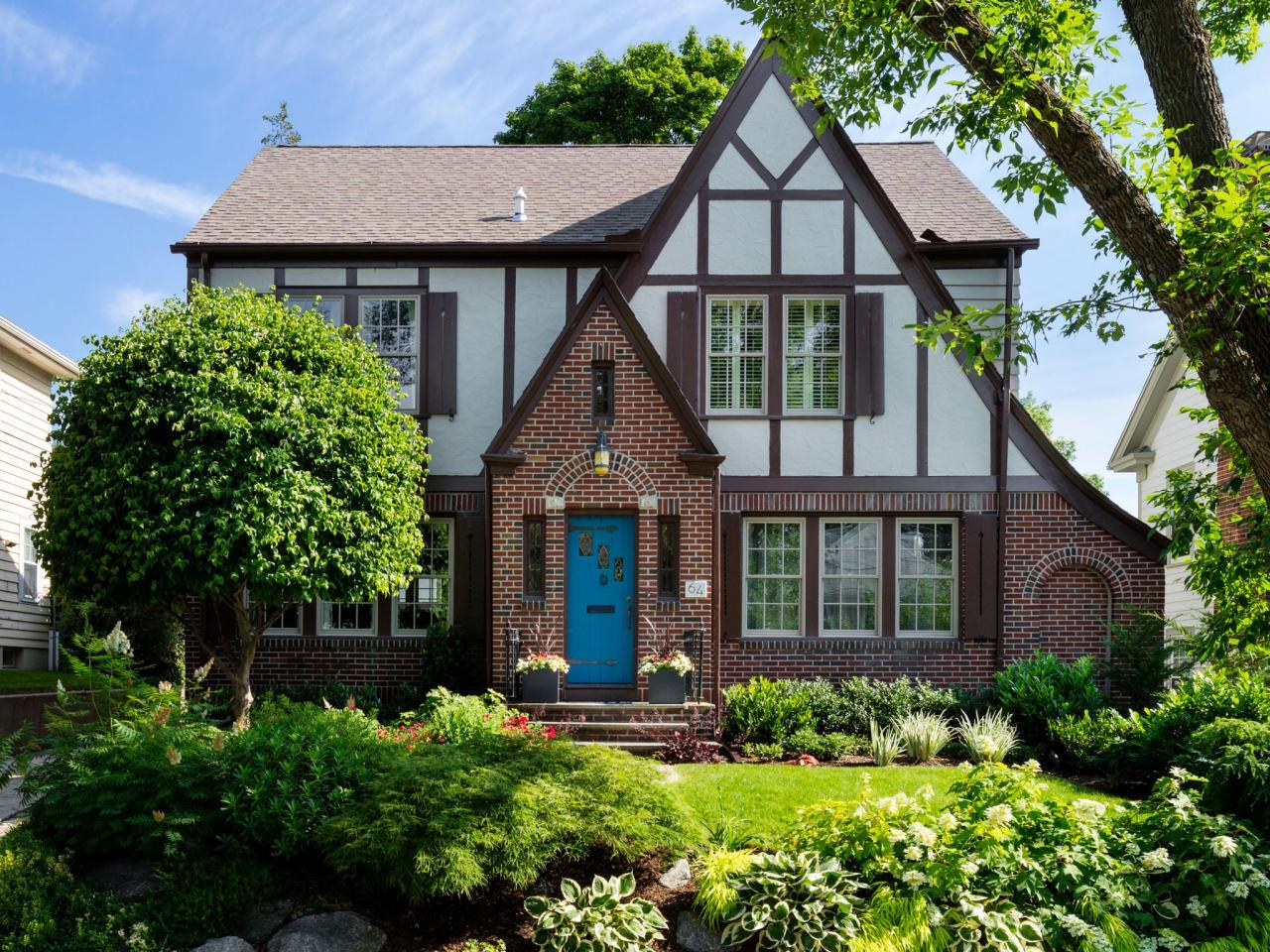 Tudor house with blue door hgtv for Blue house builders