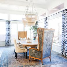 Blue And White Eclectic Dining Room With Tall Wingback Chairs