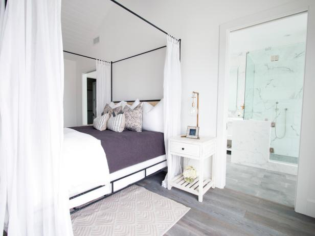 Serene White Master Bedroom With Black Canopy Bed
