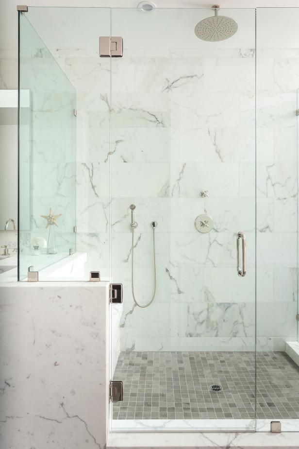 Frameless Glass And Marble Shower In Master Bathroom