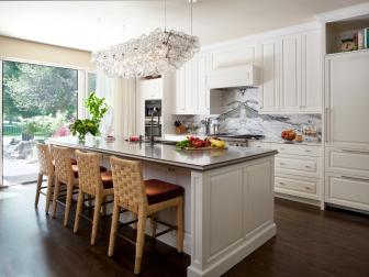 White Open Plan Transitional Kitchen With Barstools