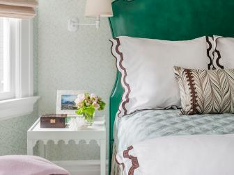 Tall Green Headboard, Spotted Upholstered Stool and Crack Patterned Wallpaper in Transitional Bedroom