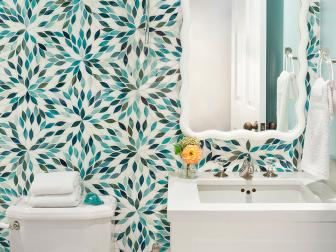 Turquoise Flower Petal Wallpaper in Contemporary Bathroom With Sleek White Vanity Sink and Sconce With Pom Pom Trim