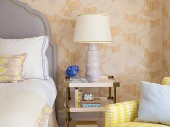 Neutral Floral Wallpaper, Gray Upholstered Headboard and Bright Yellow Arm Chair in Transitional Bedroom