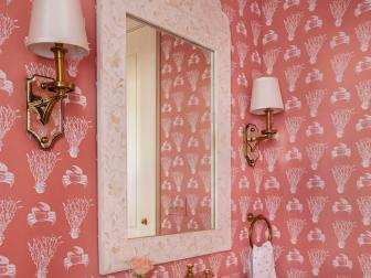 Seaweed and Crab Pink Coastal Wallpaper Around Bathroom Standing Sink and Decorative White Mirror Frame