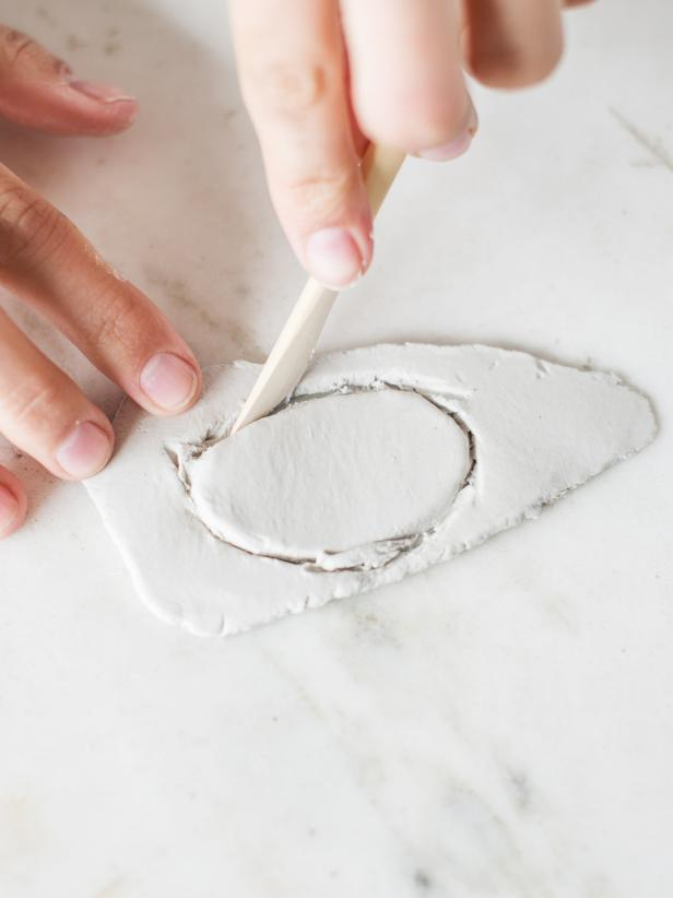 Step 2: Cut ClayUse a wooden clay knife (or kitchen knife) and cut clay in desired shape.  Smooth out rough edges by wetting a finger with water and running it along the edge.