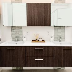 modern bathroom vanity with woodgrain cabinets built in his and hers sinks and vertical stone tile backsplash strips