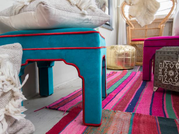 Vibrant, Colorful Porch Details Featuring Upholstered Stools, Striped Multicolor Rug and Metallic Floor Cushion