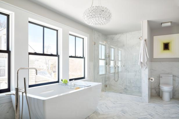 Contemporary White Master Bathroom With Marble Floors