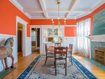 Eclectic Orange Formal Dining Room With Fireplace