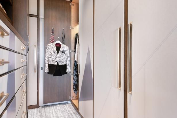 Master Closet Outfitted With Wall-to-Wall Wardrobes and Drawers