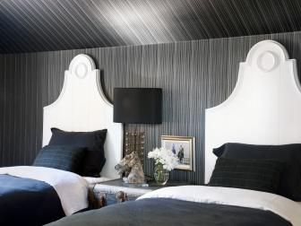 Eclectic Black Bedroom With White Twin Headboards