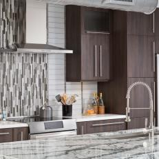 sleek contemporary kitchen with vertical tile backsplash panel gray marble island countertop and woodgrain cabiets