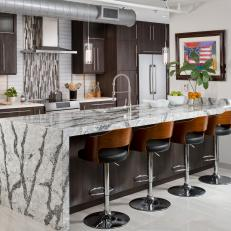 gorgeous contemporary kitchen with thick gray countertop marbling wood back barstools and vertical tile backsplash