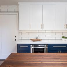 Navy Cabinets In All White Kitchen