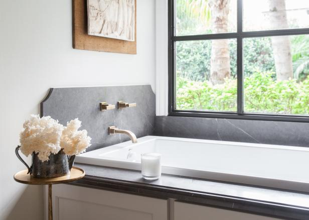 Soaking Tub With Gray Marble and Flowers