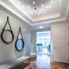 Foyer With Hardwood Flooring and Unique Chandelier