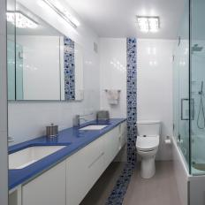 Modern Bathroom With Blue Topped Floating Vanity