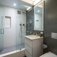 Modern Bathroom With Glass Shower and Single Vanity