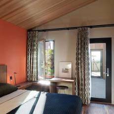 Pop of Orange in Mod Guest Room