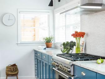 Stylish Galley Kitchen With Bright Blue Cabinetry