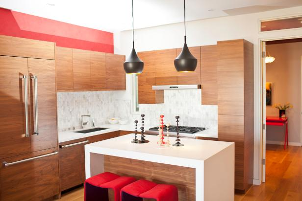 Brown and Red Modern Kitchen With Black Pendants