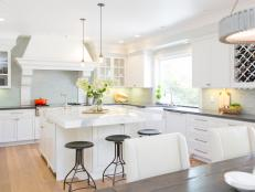White Cottage Kitchen With Black Barstools