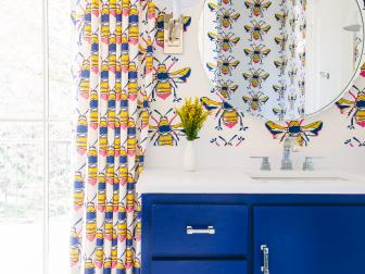 Bee Patterned Bathroom with Bold Colors and Penny-Round Tile Floor