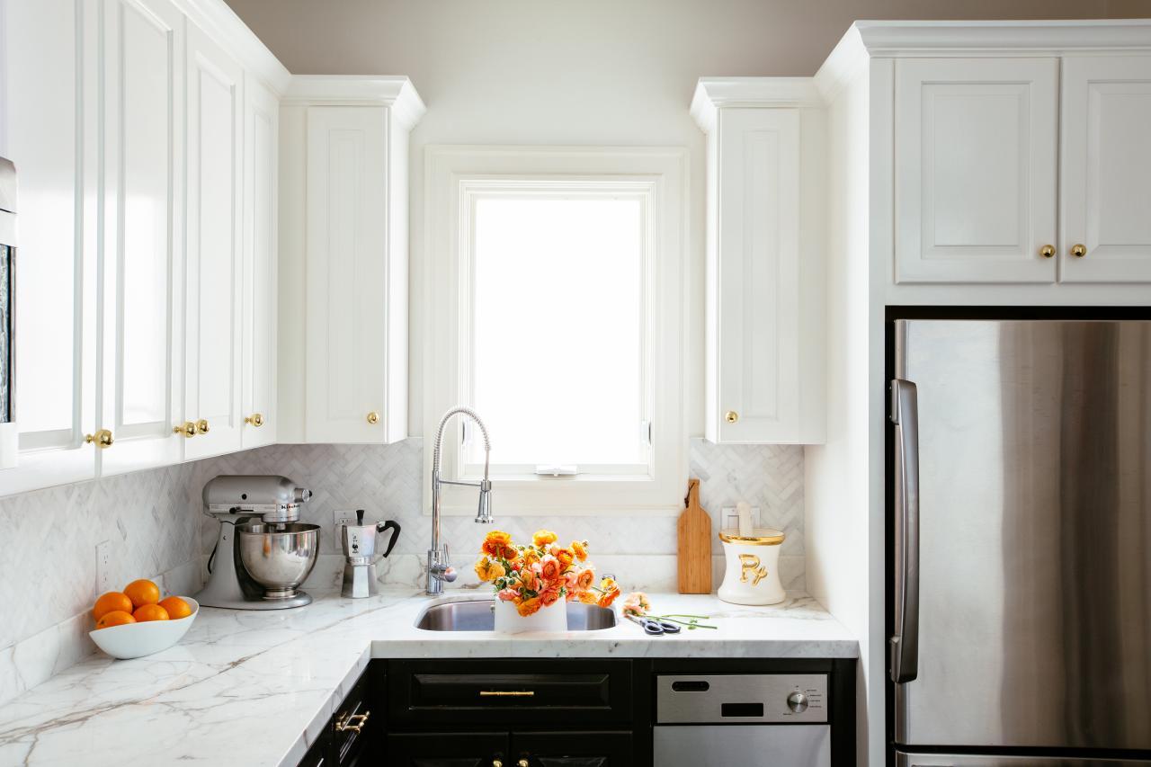 white herringbone backsplash and white marble countertops in bright
