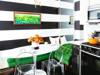 Black and White Striped Kitchen With Modern Dining Table, Tufted Green Corner Bench and Clear Plastic Chairs