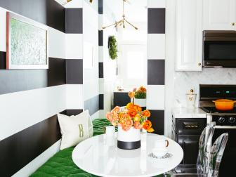 Large Black and White Wall Stripes in Contemporary Kitchen Corner With Kelly Green Bench and Small Circular Table