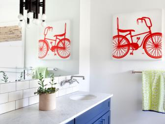 Kids Bathroom With Frameless Mirror and Bicycle Art