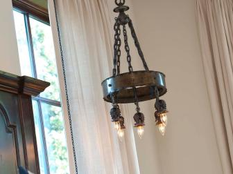 Old World Chandelier in Spanish-Inspired Bedroom