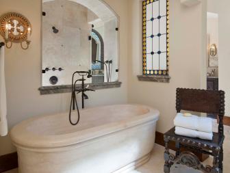 Timeless Stone Bathtub in Spanish Master Bathroom