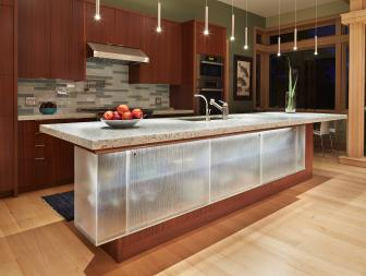 Sleek, Modern Kitchen With Glass-Front Island