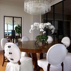 Dining Room With Orchid Centerpiece