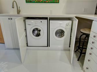 Cabinet Concealed Front Load Washer and Dryer Under Light Gray Granite Countertop With Built In Sink