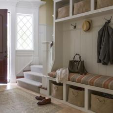 Neutral Transitional Mudroom With Striped Benches