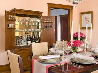 Peach-Hued Traditional Dining Room With Elegant Chandelier