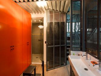 Parisian Loft Bathroom With Bright Orange Cabinet