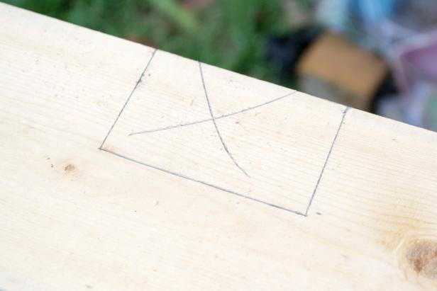 Use a straightedge to connect the tops of the parallel 2 ½ inch lines. This marks the cutout for the rear roof support.
