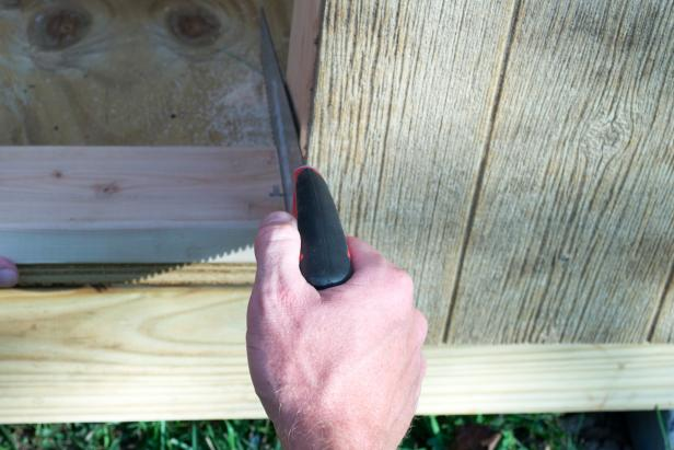 Cut out the bottom part of the door frame with a handsaw.