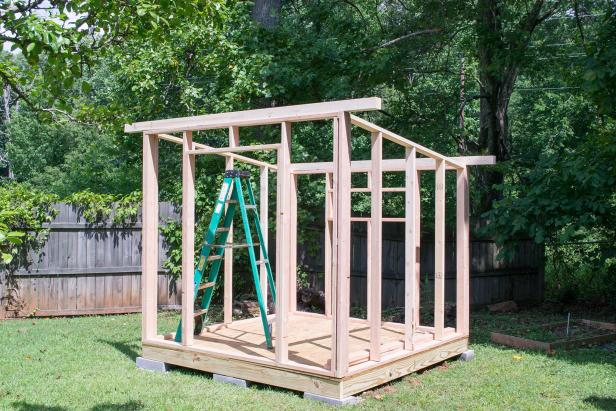 Make (2) roof supports by nailing (2)ten-foot 2x4's double thick for each one. Use 3-inch exterior screws to attach the roof supports over the front and rear walls by screwing up through the wall plate from below.