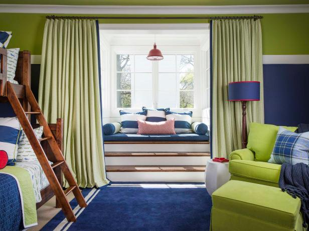 Bold Green and Blue Two-Tone Kids Bedroom With Wood Bunkbeds and Pillow Padded Window Seat